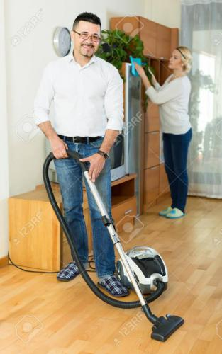 Man and his wife cleaning at home